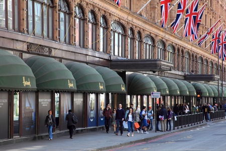 London, United Kingdom, May 1, 2011 : Exterior of Harrods department store in the Brompton Road, Knightsbridge showing shoppers passing by