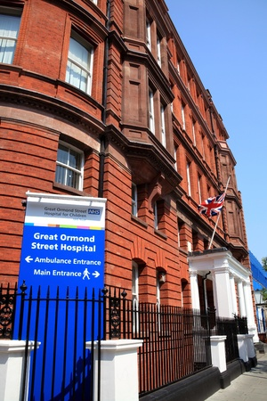 London, United Kingdom, Apr 30, 2011 :  The front entrance of Great Ormond Street Hospital for Children in Bloomsbury with an information sign in the foreground