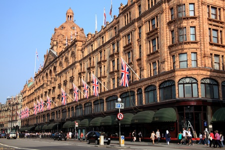 London, United Kingdom, May 4, 2011 : Exterior of Harrods department store in the Brompton Road, Knightsbridge showing shoppers passing by Editorial