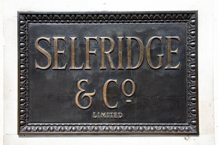 London, United Kingdom, May 1, 2011 : Bronze  logo sign of Selfridges department store in Oxford Street  Stock Photo - 9541781