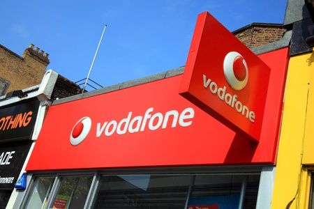 London, United Kingdom, Apr 17, 2011 : Vodaphone logo advertising sign on one of its branch retail outlets in Notting Hill