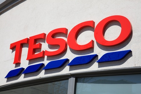 Portsmouth, United Kingdom, Apr 22, 2011 : Tesco logo advertising sign outside one of its retail supermarket stores in Portsmouth city centre Editorial