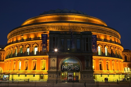 London, United Kingdom, Aug 9, 2007 : The Royal Albert Hall in Kensington Gore at night displaying advertising banners for the yearly proms