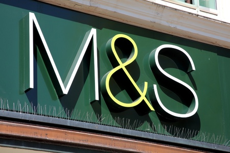 Portsmouth, United Kingdom, Apr 22, 2011 : Marks & Spencer (M & S) logo advertising sign outside one of its retail supermarket stores in Portsmouth city centre Editorial