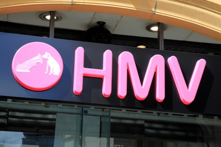 record shop: London, United Kingdom, May 8, 2011 : HMV Nipper logo advertising sign outside one of its retail  stores in Leicester Square