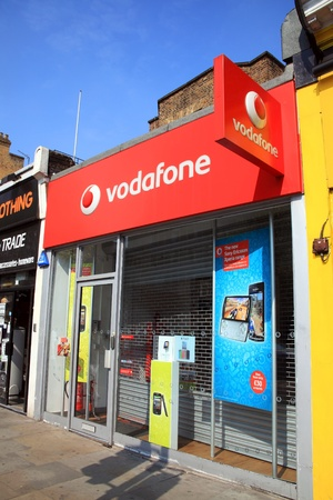 London, United Kingdom, Apr 17, 2011 : Vodafone advertising signs at one of its branch retail outlets at Notting Hill Gate