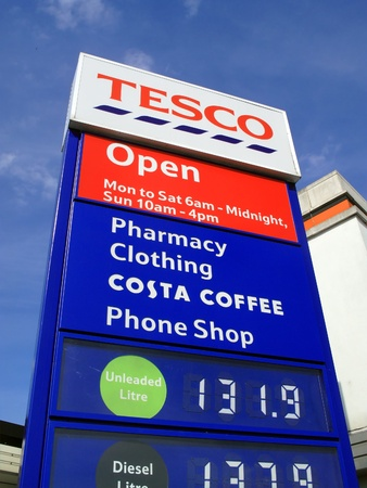 London, UK, Jun 14, 2011 : A Tesco petrol station sign showing its company logo and petrol price at its Perival supermarket on the Western Avenue Stock Photo - 9730221