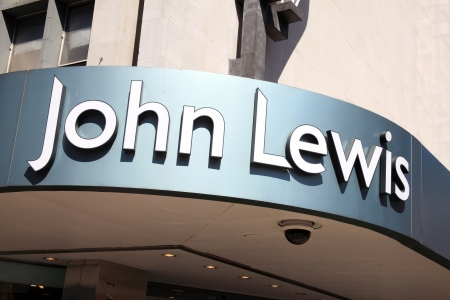London, UK, Jun 29, 2011 : Exterior of the John Lewis department store in Oxford Street showing its name sign above its entrance Editorial
