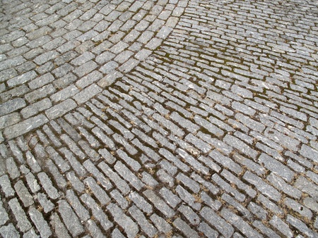 brick road: Old fashioned patterned cobbled pathway background