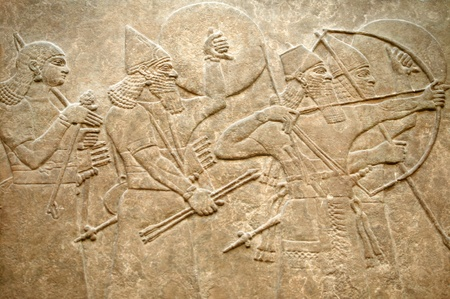 ancient soldiers: Assyrian 8th century BC relief showing Assyrian soldiers in battle