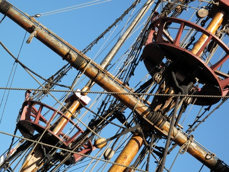 drakes: Rigging and crows nest of the Golden Hinde which is docked at the side of the River Thames. It is a full sized exact replica of Sir Francis Drakes 16th Century warship which he use to circumnavigate the world along with a little piracy on the way