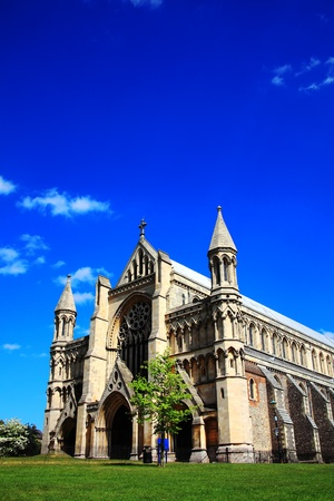 St Albans Cathedral in St Albans, Hertfordshire, England with a blue sky, some clouds and copy space. Although of a Norman structure the Cathedral Stock Photo