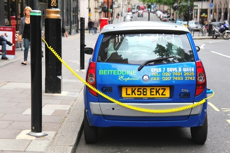 London, UK, Jun 19, 2011 : Electric car  having its battery recharged at a charging point post in Berkeley Square Stock Photo - 10274098