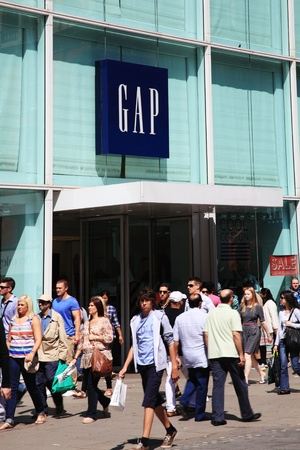 London, UK, Jul 24, 2011 : Entrance of  The Gap clothing store in Oxford  Street with people shopping on a busy day