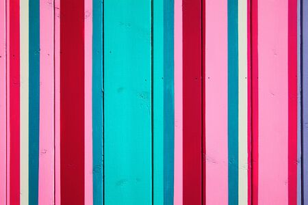 Painted candy striped wood planks background photo