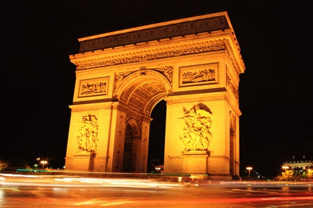 Arc de Triomphe: Night shot of the  Arc De Triomphe in Paris France with a slow exposure showing light trails left by passing cars