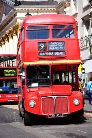 London, UK – Apr 9, 2011: No 9 London Routemaster red double decker bus on its journey across London to Aldwych, one of two remaining heritage routes. The Routemaster is a profitable fare paying tourist attraction