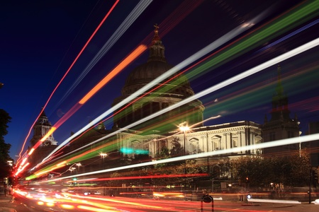 St Paul Cathedral in London, England, UK at  night with blurred motion, traffic tail lights and headlights. Built after The Great Fire Of London of 1666, it is Christopher Wren masterpiece and one of the visited tourist attractions in London