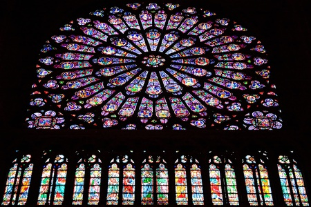 The Rose Window of Notre Dame Cathedral in Paris, France. The cathedrals construction began in 1163 and was completed by 1345