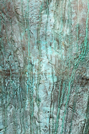 verdigris: Bronze weathered background covered in rough green verdigris