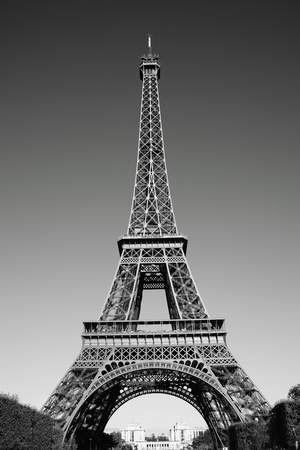 Monochrome black and white picture of The Eiffel Tower at the Champ-De Mars in Paris, France, which is 300m tall and built in 1889 for the Exposition Universelle on the centenary of the revolution Standard-Bild