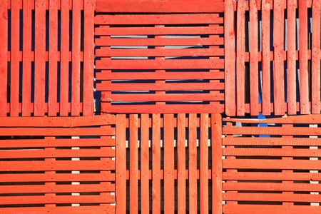 Abstract background of old wooden pallets made into an orange fence photo