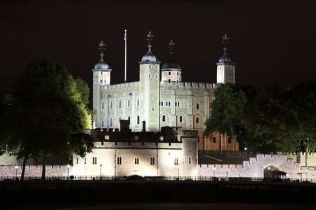 conqueror: The Tower of London at night which was built by William The Conqueror in 1078 and is a Norman fortress and former royal palace standing on the north bank of the River Thames
