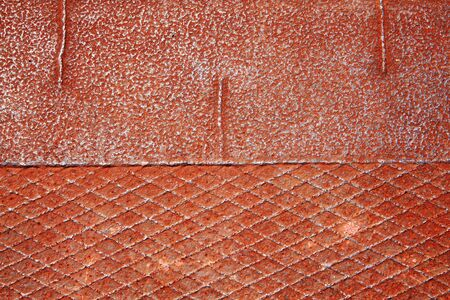 footplate: rust covered iron sheet metal background