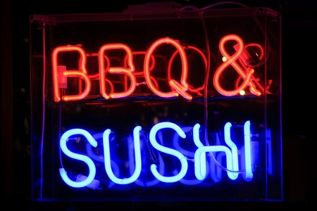 florescent light: neon sign at night advertising sushi and barbecue meals