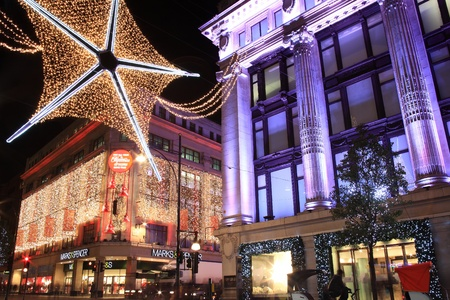London, UK - November 10, 2011: The Christmas lights decorations outside Marks & Spencer and Selfridges at night, in Oxford Street during the festive season. Stock Photo - 11175650