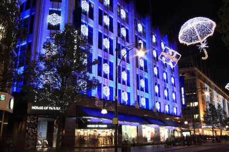 London, UK - November 10, 2011: The Christmas lights decorations outside House Of Fraser at night, in Oxford Street during the festive season. Stock Photo - 11175649