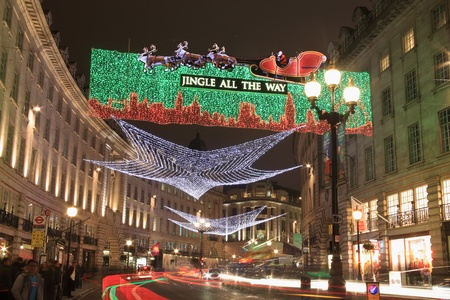 London, UK - November 12, 2011: Christmas lights display along Regent Street ,with blurred light trails from passing vehicles, during the festive season.