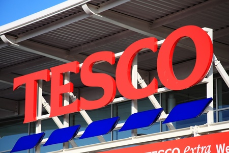 wembley: London, UK � Nov 19, 2011:  Tesco logo advertising sign outside its retail supermarket stores in Brent Park Wembley