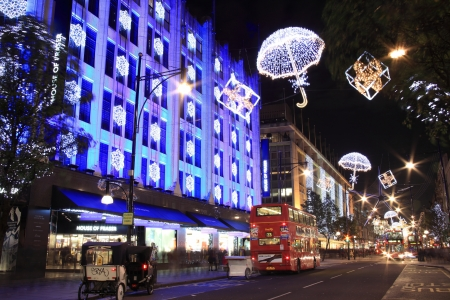 christmas lights display: London, UK - November 10, 2011: The Christmas lights decorations outside House Of Fraser at night, in Oxford Street during the festive season.