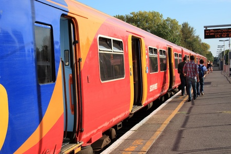 south west england: East Molesey, UK – Oct 1, 2011: A South West train waiting for passengers to board at Hampton Court Station for its destination to Waterloo Station. Editorial