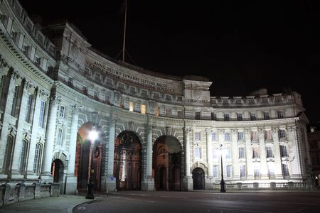 Admiralty Arch at night , which was completed in 1912 and commissioned by Edward V11 in memory of his mother Queen Victoria. It provides an archway and pedestrian access between The Mall and Trafalgar Square