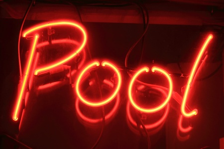 florescent light: Red pool neon sign at night outside a snooker club
