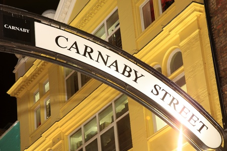 London, UK - November 1, 2011: Illuminated Carnaby Street sign in the fashionable retail clothing street that bears its name Stock Photo - 11305649
