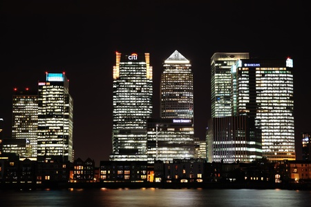 London, UK - October 20, 2011: Canary Wharf in Londons Docklands on the Isle of Dogs at night showing Citi Bank, Nat West Bank and Barclays Bank skyscraper towers