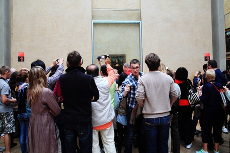 Paris, France - September 17, 2011: Tourists admiring and photographing the Mona Lisa at the  Musee Du Louvre