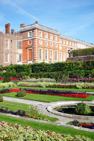 Hampton Court palace in Surrey, England, UK, the home of Henry VIII, with its landscaped Privy Garden in the foreground Stock Photo