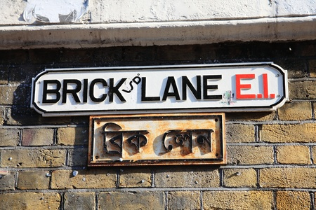 commonly: Brick Lane road sign in Whitechapel, Tower Hamlets, London, England, UK, which is commonly known as Banglatown and is the heart of the city
