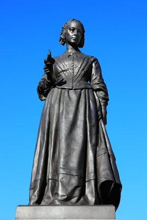 A bronze memorial statue of Florence Nightingale in Waterloo Place, Westminster, London, by Arthur Walker (1861-1939) which was unveiled in Waterloo Place in 1915. Florence Nightingale was an English nurse known as