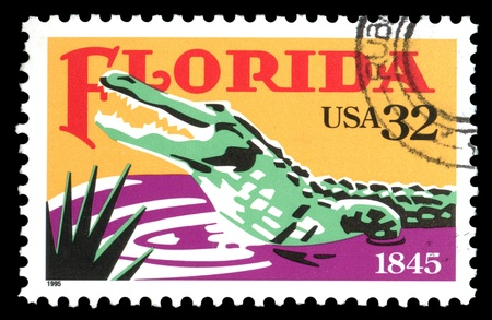 postage stamp: USA vintage Alligator postage stamp celebrating 150 years of Florida statehood Stock Photo