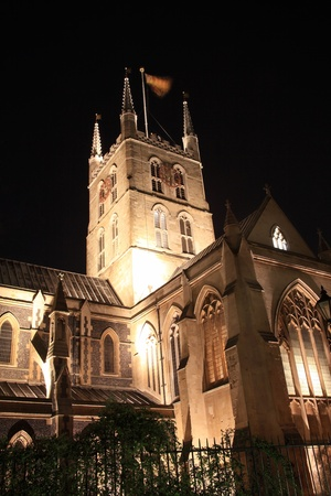 anglo saxon: Southwark Cathedral at night which stands at the south end of London Bridge, London, England, UK. It is believed to have been built around 666AD, largely rebuilt in a Norman Gothic style after a fire in 1206AD and has a memorial to William Shakespeare