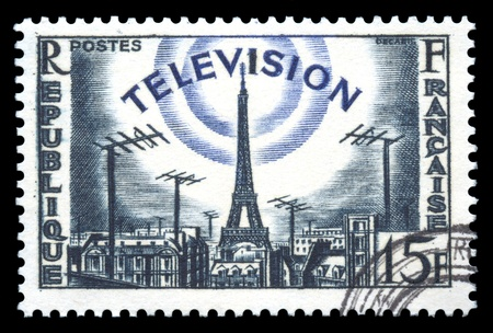 postage stamp: France postage stamp showing an engraving of television development broadcasting from the Eiffel Tower