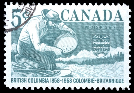 Canada postage stamp showing a miner panning for gold as part of the centenary of British Columbia Stock Photo - 12064859