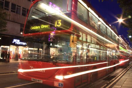 London, UK – Oct 6, 2011: No 13 London  red double decker bus at night, passing in Oxford Street, on its journey across London to Golders Green