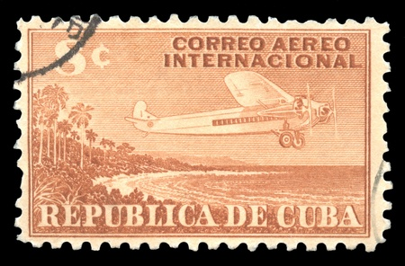 Cuba vintage 8c airmail postage stamp with an engraved image of an aeroplane flying to deliver mail photo