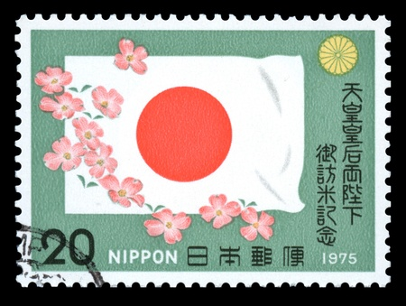Japanese postage stamp with a drawing of the national flag of Japan celebrating an American tour  by Emperor Hirohito and Empress Nagako photo